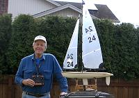 Joe with his remote controlled Thunder Tiger Victoria sailboat.